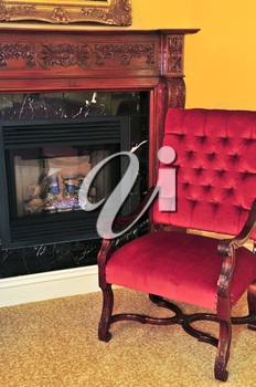 Fireplace and red chair in living room