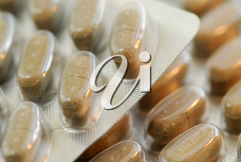 Packages of herbal supplement pills close up