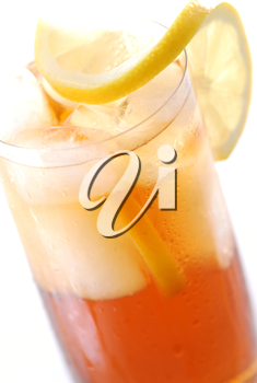 Glass of cold iced tea with water drops on surface
