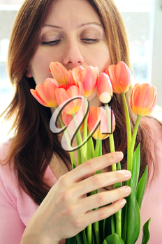 Mature woman holding bouquet of flowers