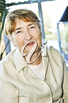 Senior woman laughing and smiling on sunny day