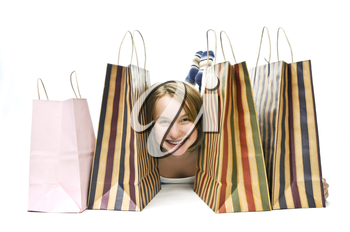Happy teenage girl with lots of shopping bags