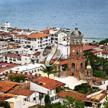 Cityscape view from above with church and Pacific ocean in Puerto Vallarta, Mexico