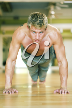 Strong, handsome man doing push-ups