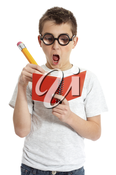 A comical boy student in geeky glasses writing in a book.  Please note eyeglasses are meant to distort eyes.