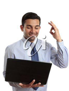 Businessman with laptop computer showing okay hand sign, approval, excellent, exceptional, recommendation, etc.  White background.