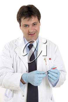 Doctor or physician with a dose of medicine or vaccine in a srringe with protective cover.