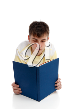 A boy reading a book, textbook, studying, learning or recreational.  White background.