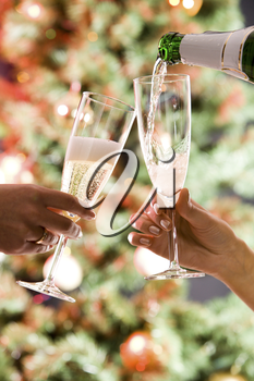 Photo of pouring a champagne on the three glasses