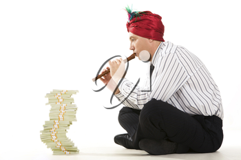 Image of entrepreneur playing the pipe with high stack of dollar bills in front