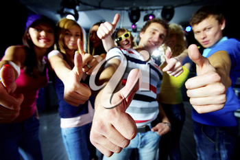 Photo of friends showing thumbs up meaning cool party