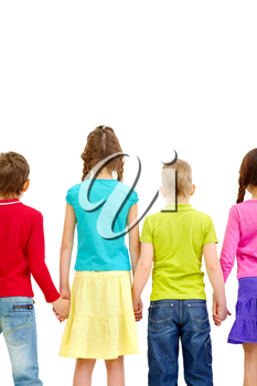 View rear of children holding by hands together