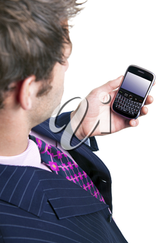 Overhead shot of a man using a mobile phone organiser, screen has a clipping path to add your own message or image. The device has been significantly altered from the original product.