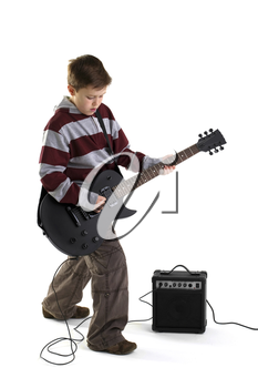 A boy playing a matt black electric guitar with amplifier, isolated on a white background.