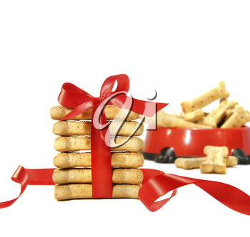 Royalty Free Photo of Dog Biscuits Wrapped in a Red Bow