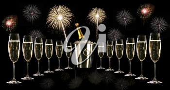Royalty Free Photo of Glasses of Champagne Around a Silver Ice Bucket With Fireworks in the Background