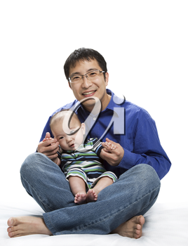 A shot of an asian father and his son