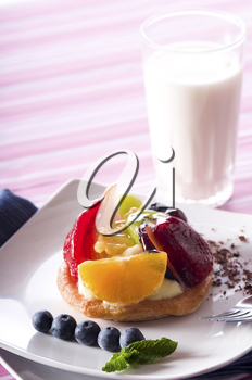 Fruit Tart on a white plate on a table