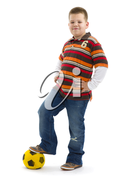 Boy wearing trendy colorful t-shirt, posing with football, smiling. Isolated on white background.