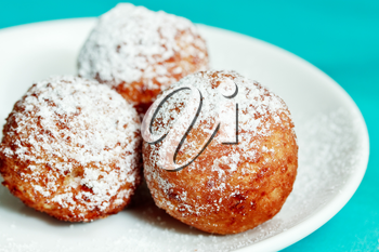 Crispy cheese balls deep fried in powdered sugar
