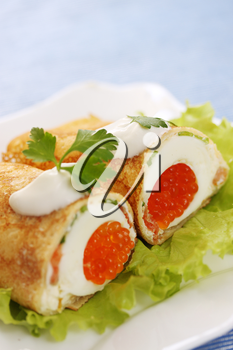 pancake stuffed with egg and red caviar