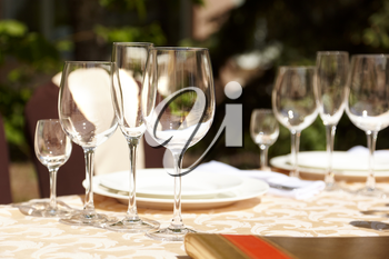 A close-up shot of wineglass in a fine open-air restaurant or on  wedding party