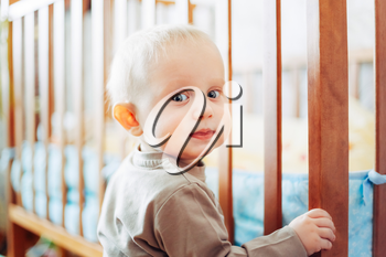 Little Child Baby Boy Smiling Standing Near Bed