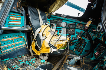 Close-up of some instruments in a helicopter cockpit in Mi-24. The Mil Mi-24 is a large helicopter gunship and attack helicopter and low-capacity troop transport with room for eight passengers.