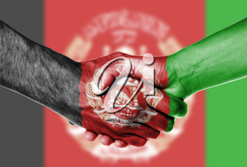 Man and woman shaking hands, wrapped in flag pattern, Afghanistan