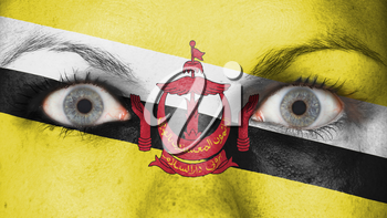 Close up of eyes. Painted face with flag of Brunei