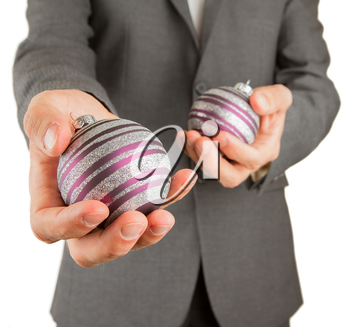 Man in grey suit is holding Christmass balls, isolated