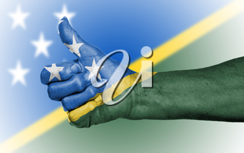 Old woman giving the thumbs up sign, isolated, flag of The Solomon Islands