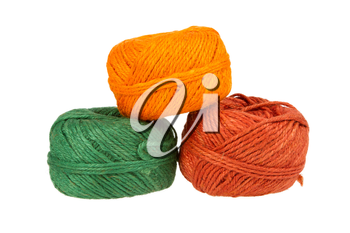 Three colours of knitting yarn isolated on a white background
