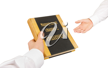Businessman giving an used book to another businessman, management chapter 1 - indifference