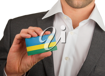 Businessman is holding a business card, flag of Rwanda