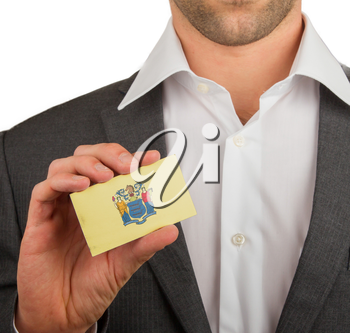 Businessman is holding a business card, flag of New Jersey