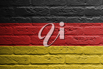 Brick wall with a painting of a flag isolated, Germany