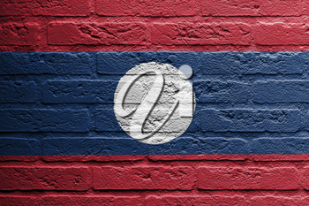 Brick wall with a painting of a flag isolated, Laos