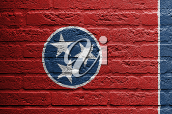 Brick wall with a painting of a flag isolated, Tennessee