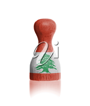 Wooden pawn with a painting of a flag, Lebanon
