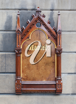 Decorative wooden sign hanging on a concrete wall - Wanted