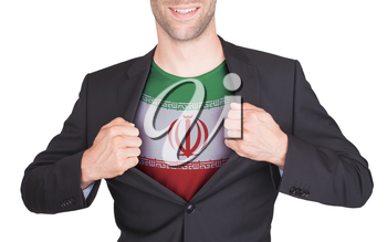 Businessman opening suit to reveal shirt with flag, Iran