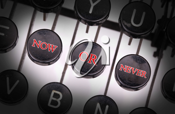 Typewriter with special buttons, now - or - never