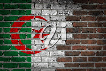 Very old dark red brick wall texture with flag - Algeria