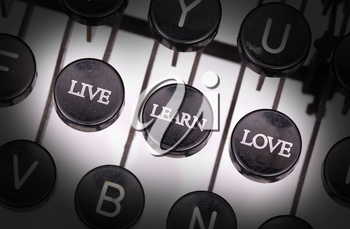 Typewriter with special buttons, live learn love