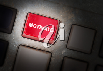 Red button on a dirty old panel, selective focus - motivate