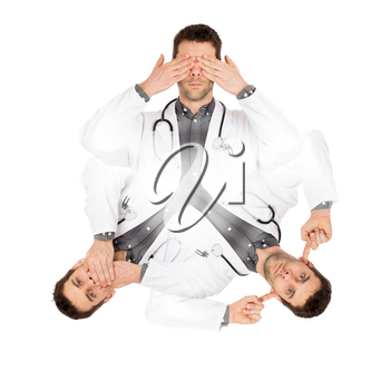 Doctor isolated on white - Sees, hears and speaks no evil - Concept for not rocking the boat in medical circles