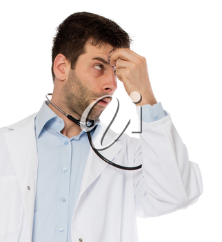 Humorous portrait of a young depressed surgeon with a stethoscope, isolated on white