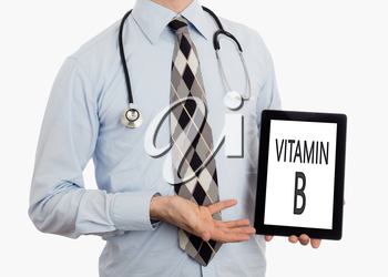 Doctor, isolated on white backgroun,  holding digital tablet - Vitamin B