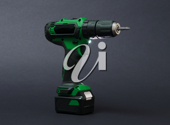 Cordless screwdriver or power drill isolated on a black background